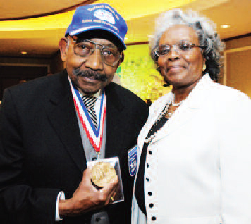 Dabney Montgomery, with his wife Amelia, displaying the Congressional Medal of Honor awarded surviving Tuskegee Airmen in 2007.